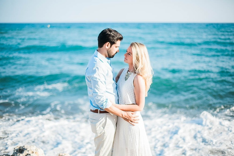 Couple in love with the sea as background